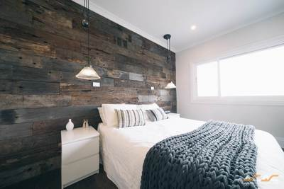 Timber feature walls in a bedroom - Weathered face sleeper panels by Northern Rivers Recycled Timber