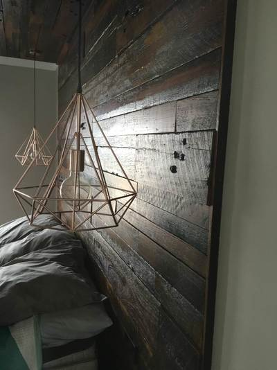 Timber feature walls in a bedroom - Artisan Run of the Mill panels by Northern Rivers Recycled Timber