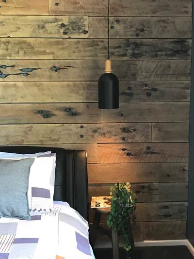 Timber feature walls in a bedroom - Doeskin Sleeper panels by Northern Rivers Recycled Timber