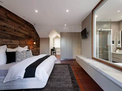 Timber feature walls in a bedroom - Artisan Sleeper panels by Northern Rivers Recycled Timber