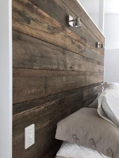 Timber feature walls in a bedroom - Wire Brushed Pipeline panels by Northern Rivers Recycled Timber
