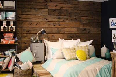 Timber feature walls in a bedroom - Artisan Rough sawn sleeper panels by Northern Rivers Recycled Timber
