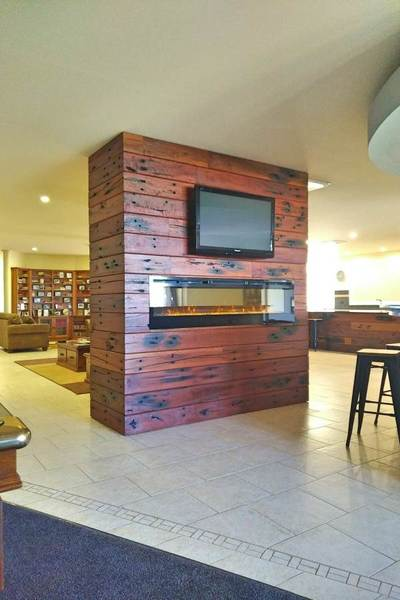 Timber feature wall in living room by Northern Rivers Recycled Timber - V-Groove Sleeper panels