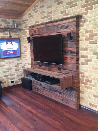Timber feature wall in living room by Northern Rivers Recycled Timber - Feature sleeper boards