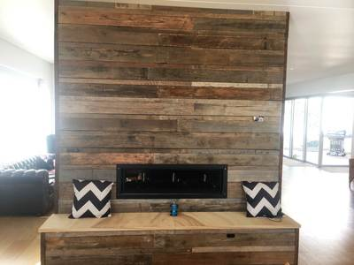 Timber feature wall in living room by Northern Rivers Recycled Timber - Brushed pipeline panels