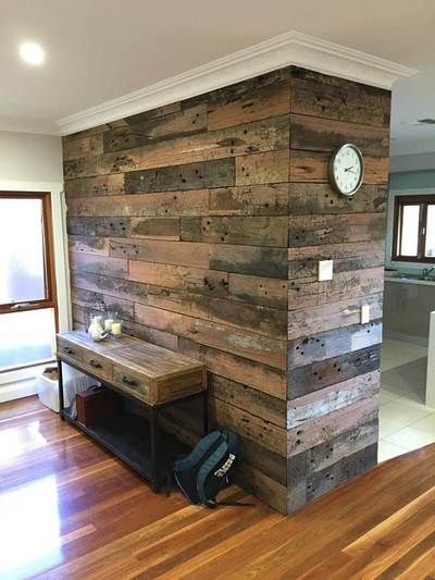 Timber feature wall in living room by Northern Rivers Recycled Timber - Artisan Sleeper panels