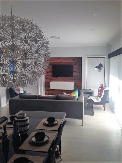 Timber feature wall in living room by Northern Rivers Recycled Timber - Tongue and Groove Sleeper boards