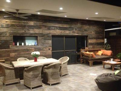 Timber feature wall in living room by Northern Rivers Recycled Timber - Weathered Face Sleeper panels
