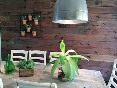 Timber feature wall in living room by Northern Rivers Recycled Timber - Rough Sawn Sleeper panels
