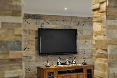Timber feature wall in living room by Northern Rivers Recycled Timber - Whitewashed Sleeper panels